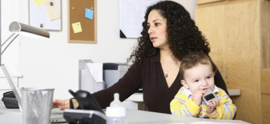 Work at home mom sitting at desk